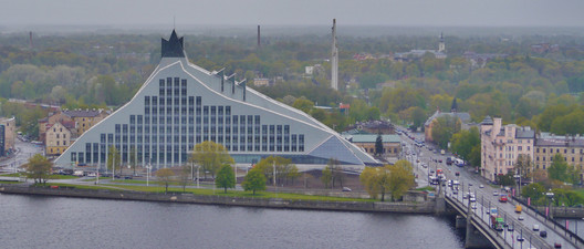 "The Latvian National Library (2014). © <a href=""https://commons.wikimedia.org/wiki/File:Riga_Petrikirche_Blick_vom_Turm_zur_Nationalbibliothek.JPG"">Wikimedia user Zairon</a> licensed under <a href=""https://creativecommons.org/licenses/by-sa/4.0/"">CC BY 4.0</a>. Image Courtesy of Zairon"