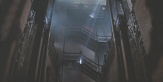 In perhaps its most famous role, the Bradbury Building reflects the eclecticism of the architecture in <em>Blade Runner</em>. Image © 1982 Warner Bros. Entertainment Inc. <a href='http://bladerunner.wikia.com/wiki/Bradbury_Building'>via bladerunner.wikia.com</a> (used under fair use)