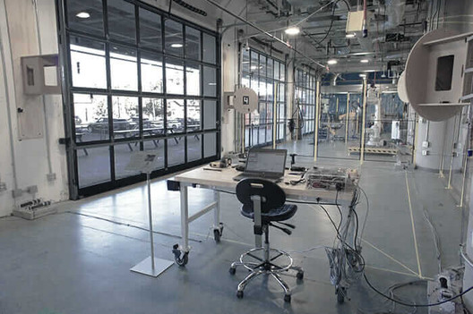 At BUILD Space, architect Simon Kim and University of Stuttgart graduate students Ayoub Lharchi and Yencheng Lu tested carbon-fiber fabrication methods. Courtesy University of Stuttgart. Image Courtesy of University of Stuttgart