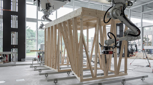 02_Robotic_Collaboration ETH Zurich Uses Robots To Construct Three-Story Timber-Framed House Architecture