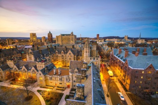 Historical building and Yale university campus in downtown New Haven CT, USA / via Shutterstock.com