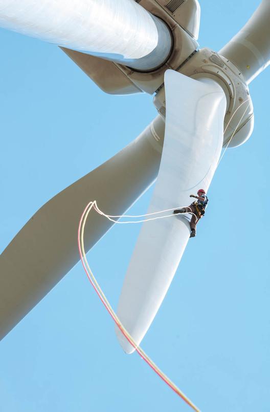 An inspector rappels down the blade of a three megawatt wind turbine in Boulder, Colorado. Image © Dennis Schroeder/NREL