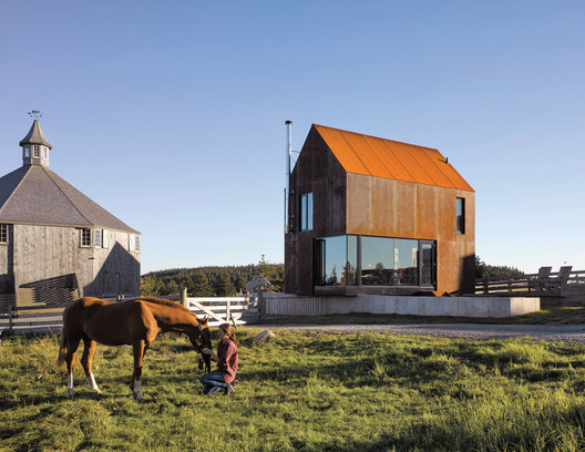 Nova Scotia–based MacKay-Lyons Sweetapple Architects has built several steel-clad gabled houses like the East Dover House, shown here, because the material blends in with cliffside landscapes, rusts to fit geology, and needs zero maintenance.. Image Courtesy of James Brittain Photography
