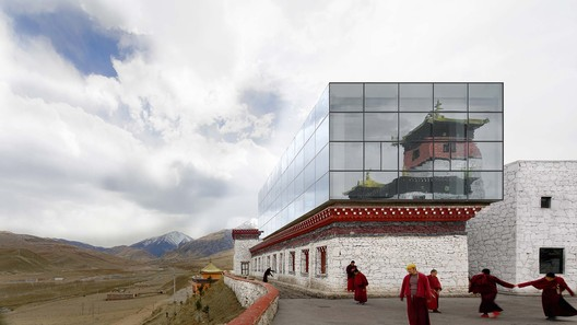 the glass of the new museum reflects the old one. Image © Hongyue Wang