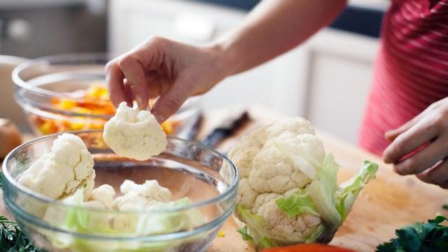 a person chopping cauliflower