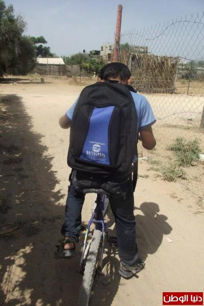 بالصور جمعية أصدقاء بلا حدود للتنمية المجتمعية توزع الحقائب