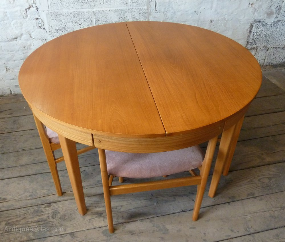 Antiques Atlas  Round Extending Teak Dining Table  4 Chairs