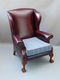 A Leather Wing Back Arm Chair - Antiques Atlas