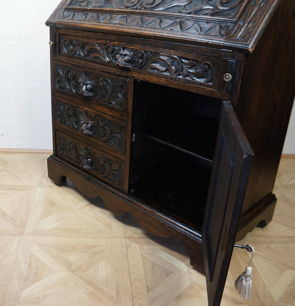 Profusely Carved Green Man Bureau Chest Of Drawers