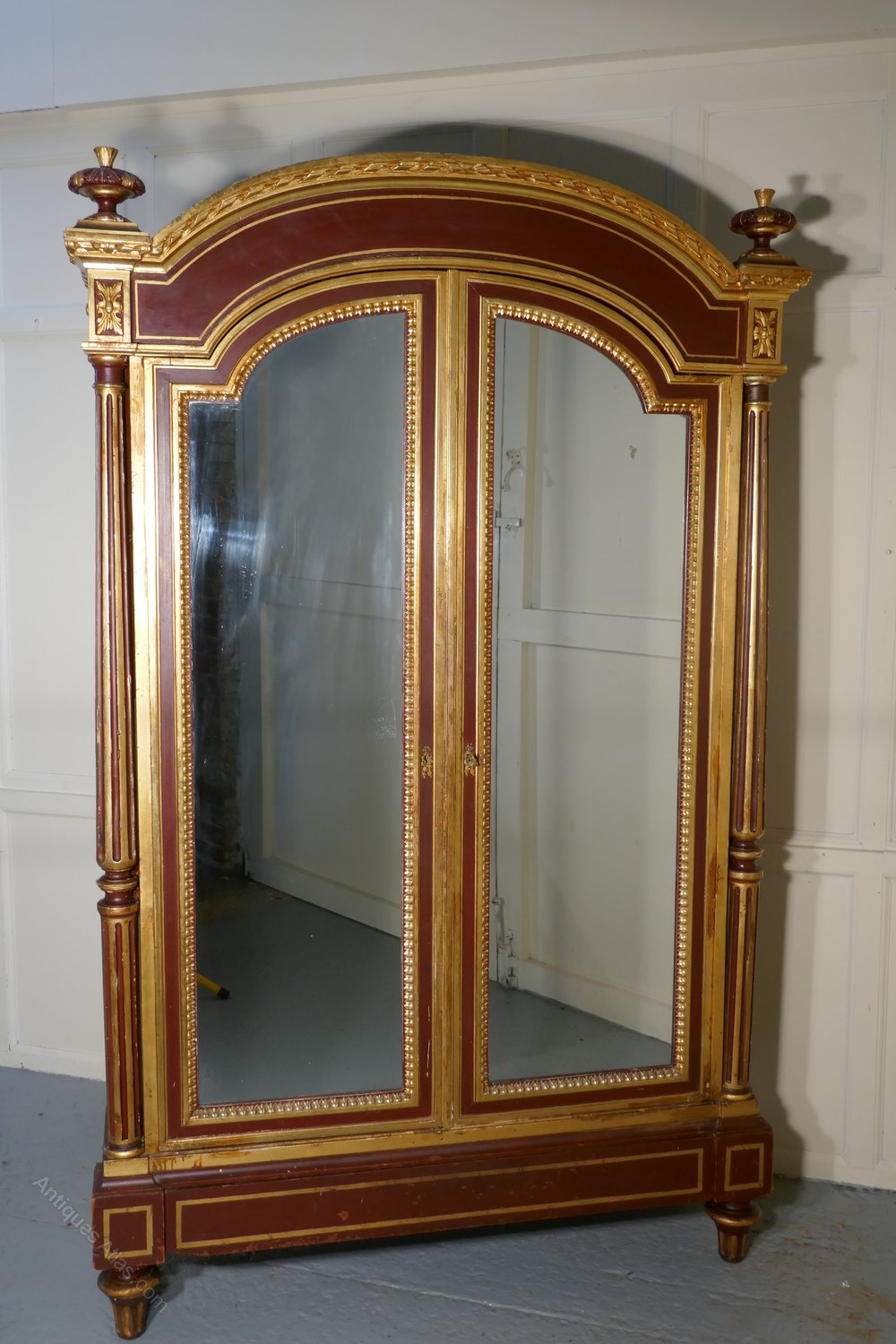 A Glamorous French Art Deco Gold Burgundy Armoire