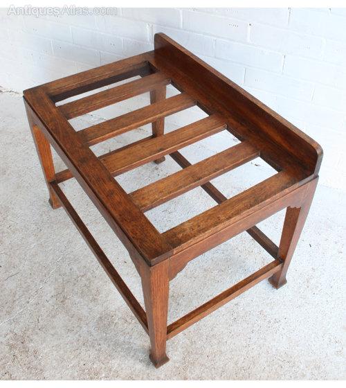 an arts crafts oak luggage rack
