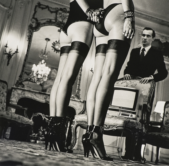 Two Pairs of Legs in Black Stockings, Paris by Helmut Newton
