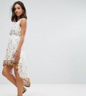 Yumi Petite Yumi Petite Dip Hem Dress in Meadow Print - White 2018