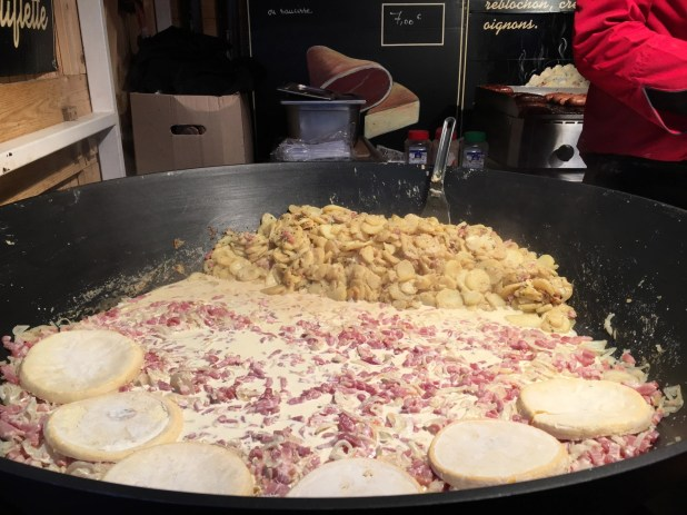 Christmas special raclette – a street food dish made with bacon, cheese and potatoes.