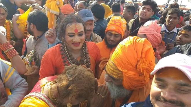 A sadhu blessing a transgender.
