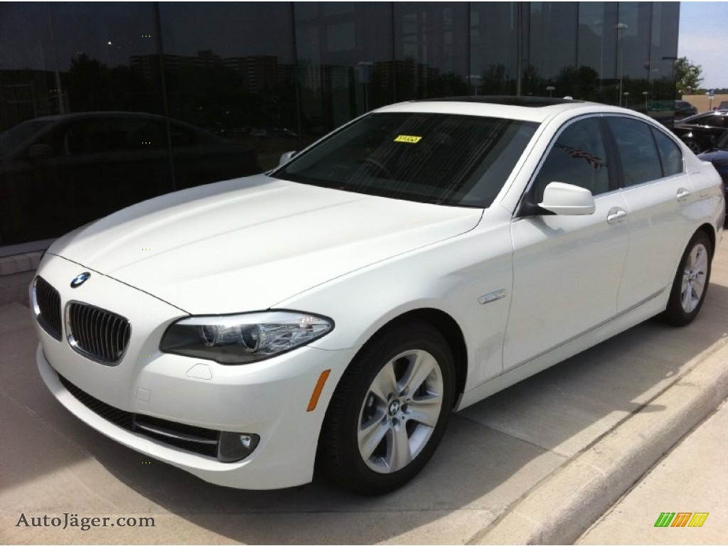 hight resolution of alpine white black bmw 5 series 528i sedan