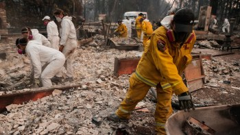 The Human Identification Laboratory sorts through fire rubble to try and find victims of the Camp Fire in Paradise, Calif. Sunday.