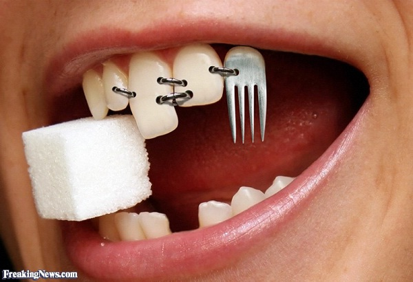 Bizarre Tongue And Tooth Piercings