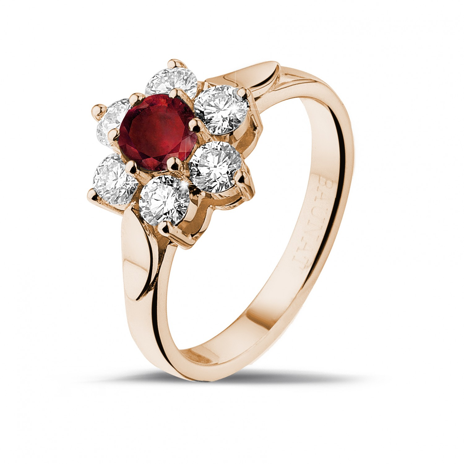 Flower ring in red gold with a round ruby and side