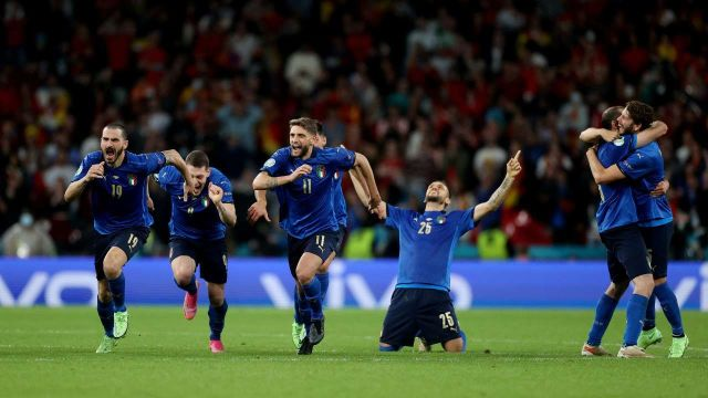Italian players celebrate after winning the penalty shootout.