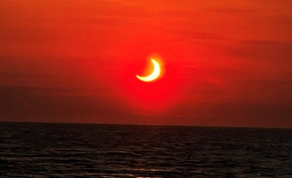 Another spectacular photo of the solar eclipse over the ocean in New Jersey.