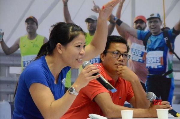 Dinko Singh with Mary Kom.