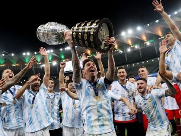 Messi celebrating with fellow players after winning the title.