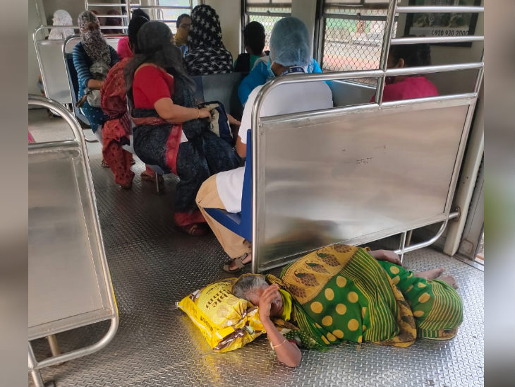 The photo is of the local train in Mumbai.  An elderly woman slept on the train as the train stopped.  In the Mumbai region, local trains were directly affected due to halt in power supply.