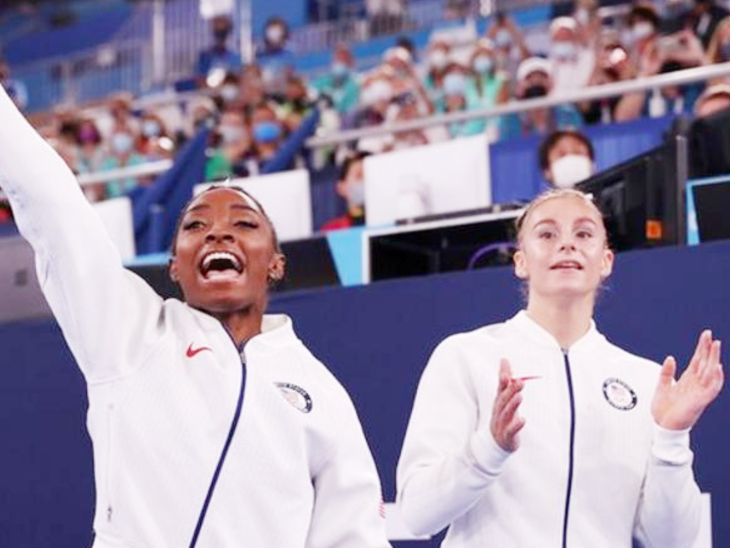 After a while, Biles returned and cheered her team in a track suit.