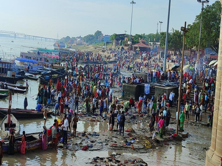 Crowd of devotees gathered at Tulsi Ghat to take bath in the Ganges.