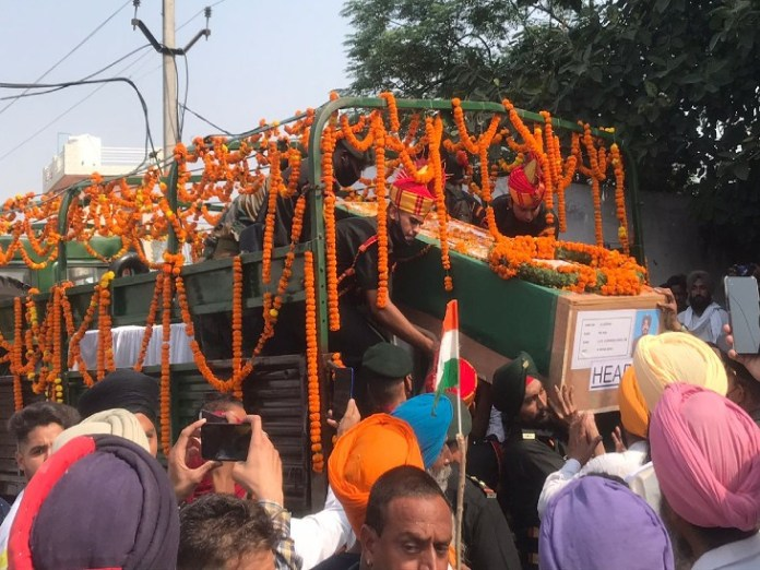 The army vehicle reached the village Mana Talwandi with the dead body of the martyr.
