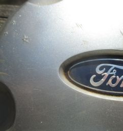 one 2002 to 2003 ford explorer hubcap center cap for alloy wheel  [ 1600 x 1200 Pixel ]