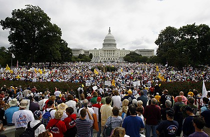 Tens of thousands of people gather on Capitol Hill in Washington to protest US President Barack Obama's health care plan.