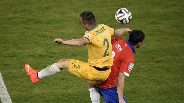 Australia's defender Ivan Franjic tears his hamstring leaping for the ball against Chile.