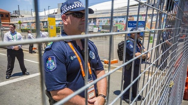 Queensland Police monitor a protest in South Brisbane ahead of the G20 leaders' summit.
