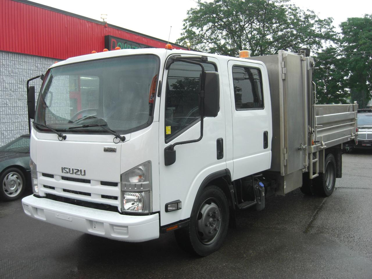 small resolution of used 2014 isuzu nqr dump truck crew cab dually for sale in london ontario carpages ca