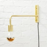 swing arm brass wall sconce | CB2