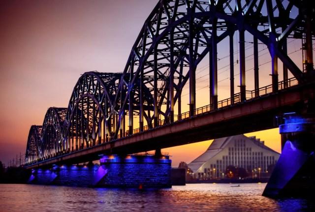 The archive shows a railway bridge over the Daugava River in Riga, Latvia.