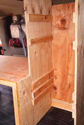 First I built the bed and the tall shelf unit filled the rest of the space between the bed and the drivers seat.