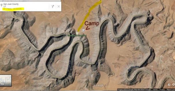 This is a Google Satellite view of the area. It looks like a winding mountain range but in fact it is a hole in the ground instead.