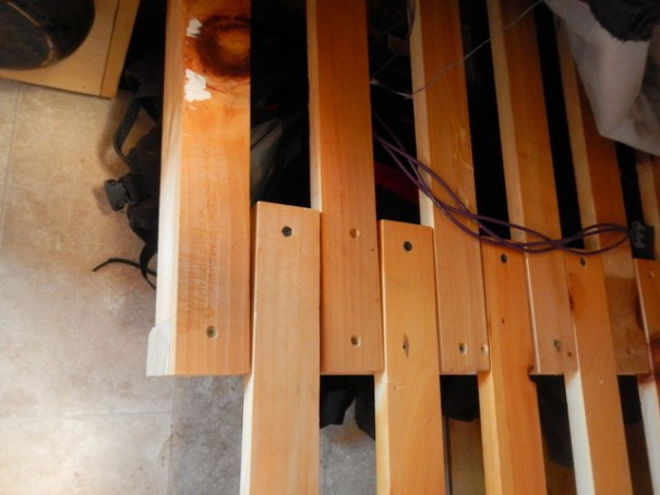 Instead of using plywood as a surface, you use overlapping slats with a gap left between them so they can slide in and out.