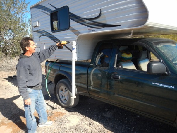 Loading it on and off is easy, but it does take some time. You use your cordless drill and an attachment to lift each corner. In order to lift them evenly, you go in a circle lifting each one a litttle at a time until you're high enough, then you drive the truck in or out. Then you reverse it to drop the camper. It's easier and safer than it sounds.
