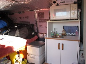Sarah's microwave stand, porta-potti, bed and insulation.