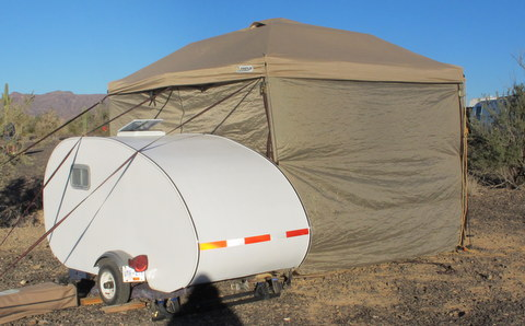 When you live in a tiny space (like this tear-drop trailer) you have to be able to get out of it during bad weather. A Pop-Up awning makes that easy.