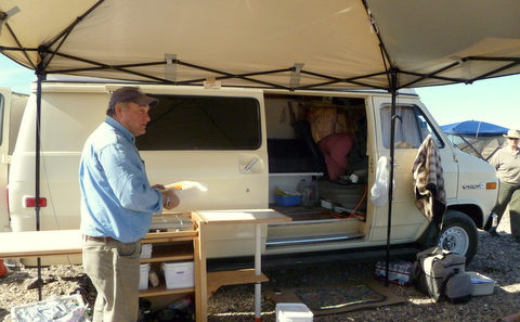 This is my friends E-Z Up style canopy awning (this one is a WalMart brand). Even in the rain he can have his door open.