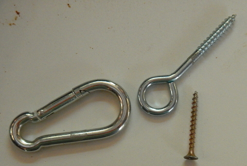 this is a spring clip and an eye screw. You can also get them as bolts instead of screws.