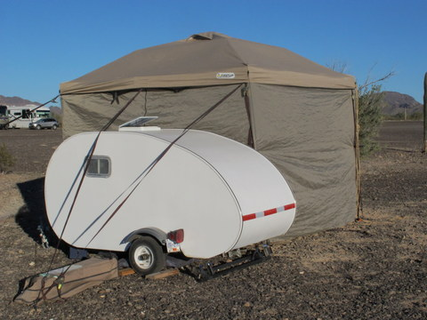 I have a friend who tows this Teardrop trailer with a Geo Metro and still gets 35 mpg. But you can't do this in the city.