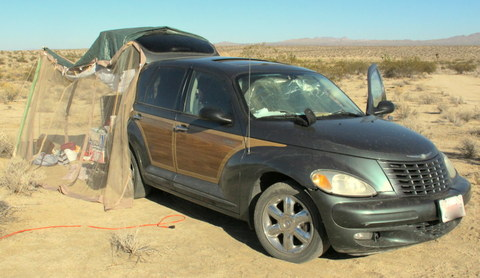 I have a dear friend who lived in this PT Cruiser and camped with me for 6 months while she saved money to buy a van. Using very little money she built a little tent room over the hatch of the car. It made her 6 months in the car much more pleasant.