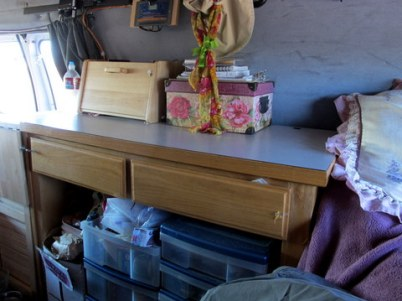 The desk she found at a thrift store that was wide enough to straddle her wheel-wells.