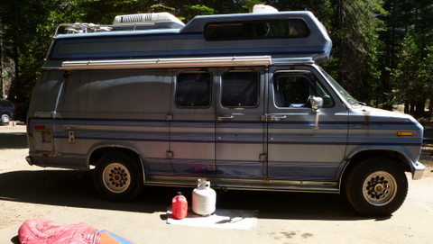 Here we see a fairly typical Class B camper van. It has a high-top, air conditioner, and awning. It's very comfortable, but obviously someone might be living in it, so it has very low stealth.